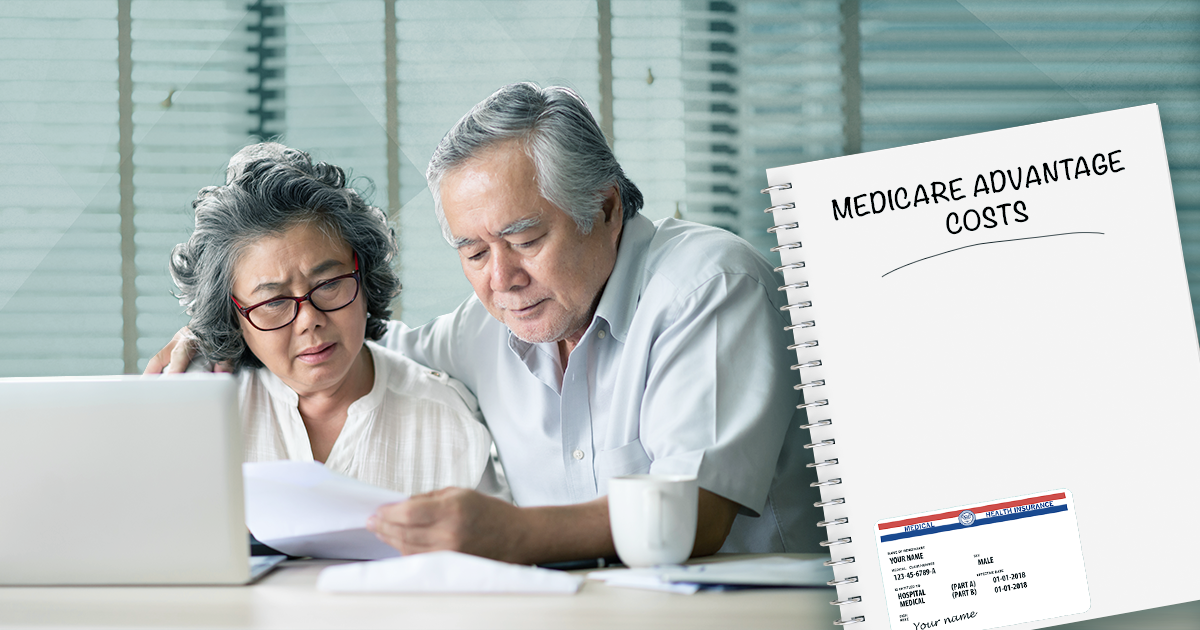 couple looking at paper; medicare advantage costs